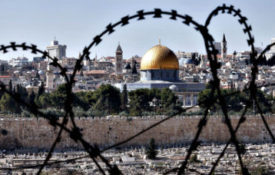 "TOPSHOTS The Muslim holy site of the Dom...TOPSHOTS The Muslim holy site of the Dome of the Rock on the Al Aqsa mosque compound in the Jerusalem Old City is seen through barbed wire on November 10, 2014. The ongoing tension over Jerusalem's flashpoint Al-Aqsa mosque compound is inflicting a ""stab wound"" on the peace treaty between Jordan and Israel, Prime Minister Abdullah Nsur said. AFP PHOTO / THOMAS COEXTHOMAS COEX/AFP/Getty Images"